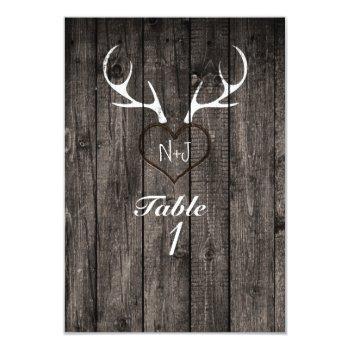 rustic deer antlers & carved heart table number